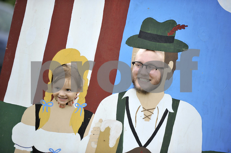 -Messenger photo by Hans Madsen<br /> <br /> Evelyn Netz, 2, of Des Moines, along with her dad, Ethridge Netz, get into the spirit of Oktoberfest Saturday afternoon. Netz was looking forward to hearing headliner band Sawyer Brown perform.