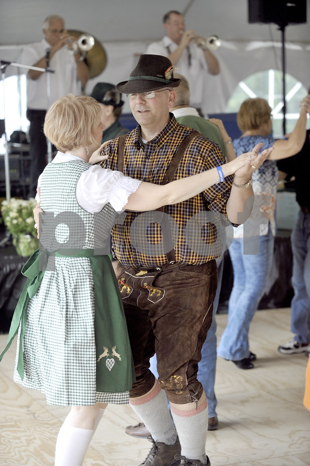 -Messenger photo by Hans Madsen<br /> <br /> Mark Steinberg, of Fort Dodge, dances with his wife Caroline to the music of Malek's Fishermen Saturday afternoon at the 2016 Oktoberfest Celebration in Oleson Park.