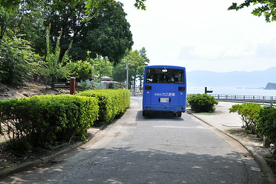 The island is mostly void of traffic other than the island buses and other small working vehicles.