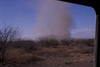 A dust devil chases us on our way to Lengai. #ODL2004-10