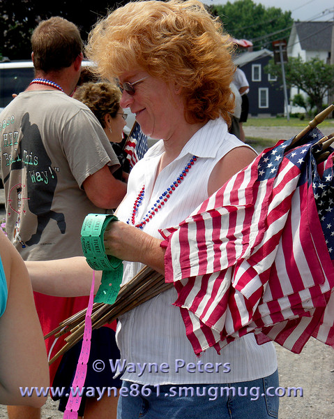 Jane hands out flags and tickets for ice cream and rides at Carousel Park. 2006 Fourth of July Parade in Olcott, New York.
