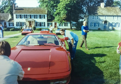 My dad looking at a Testarossa