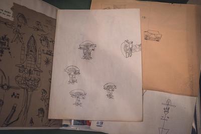 Old drawings of ED-209 from Robocop, Lamborghini, etc