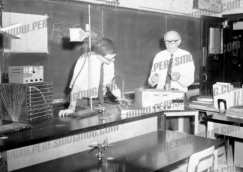 On the right is Jack Saroff, physics teacher at the high school.