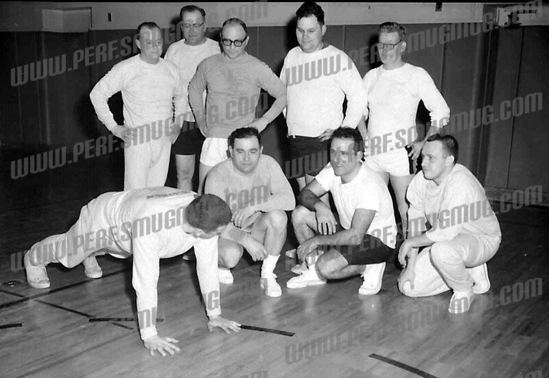 "Ned Alpert wrote about this photo on Sep 17;<br /> My father, Stan Alpert (3rd from left, back row), intent on the demonstration of the ""perfect pushup""."