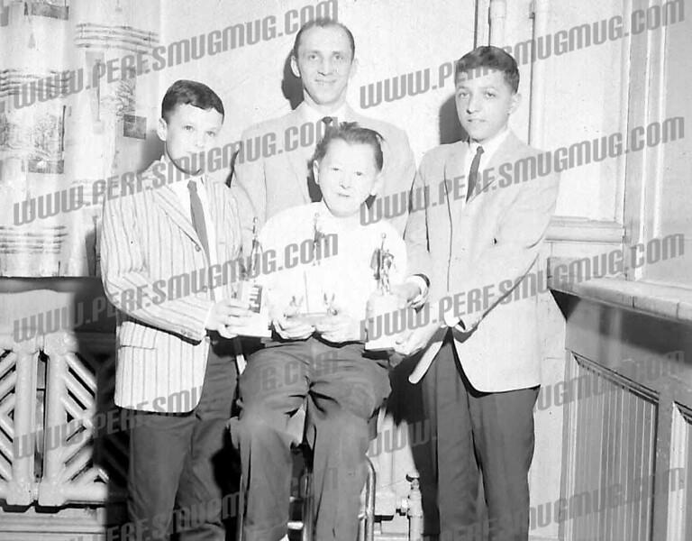 Standing Bernie Welch, Coach Joe Babrow, Joe Bialobok, c. 1963