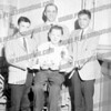 Standing Bernie Welch, Coach Joe Babrow, Joe Bialobok, c. 1963