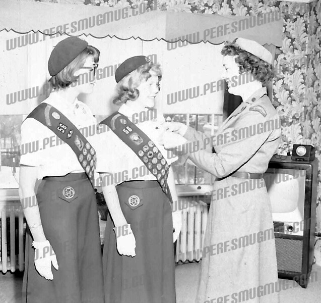 Cathy Gallagher Teal wrote about this photo on Oct 11th;<br /> This picture is my mom, Barbara Gallagher, the girl scout leader, pinning an award on my sister Sandy Gallagher Kolojay, ( middle). I don't know the other girl but I'm sure Sandy knows. I remember that wallpaper in our living room on Arnold Ave.... Brings back so many memories! Thank you