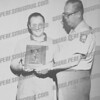 "Saint John's Lanes (now Elks Club).....Chet Wall (Sheriff)who took care of the alley's for quite a few years presenting an award to one of the Greco""s"
