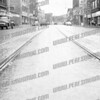 Trolly Tracks in view on Main St eastward; Mohawk Theater on right & St. Mary's Curch on left in distance.