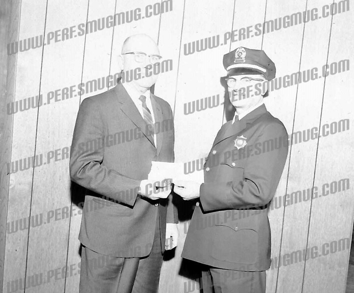 Detective Victor Stark being given his retirement badge by Chief Jacob J. Bush