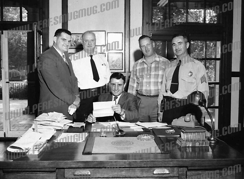 Mayor Frank Martuscello, center seated.Al Luzinas on left. Later Police Chief, may have been head of detective bureau here. mayor's office, City Hall c. 1961