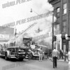 Firefighters are shown pumping water into the Sherwin-Williams Paint Co. at 42 Market St. on Aug. 30, 1955