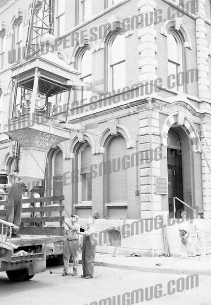Bob Going wrote about this photo on Oct 8th;<br /> <br /> Coming or going? Famous clock on 49 E main Street branch of State Bank of Albany started in Amsterdam, got hijacked to Albany, returned in mid 60's and left again for Troy in 1971. From the context of the next picture, looks like this was first removal in 1950's