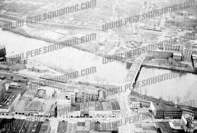 Good view of how Main Street and downtown used to connect easily with Bridge Street on South Side, forming one large business district., as it had existed from mid 19th century when first bridge connected at same spot. 1950's.