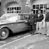 A new 1960 Ford station wagon is put into service as the chief's car at central station on W. Main St. Looking over from l-r are Fire Chief Sam Palombo, Capt. Lou Eckelman, and Driver Chet Tumidajewicz Apr. 5, 1960