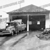 Fire Chief Ed Schwartz checks out damage to a car at a garage fire on 24 Crane St. Jan. 9, 1959