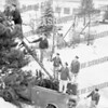 Putting the lights on the tree at Coessens Park the scene of Amsterdam's first Christmas Village. Santas arrival will officially open the 1958 Christmas Festival. Top of ladder AFD Frank Rowe, Art Graff, Robert Forbes, Walter Willis, Lt. Ken Dietrich, and Dave Costello.