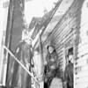 Garage fire at 110 Floida Ave. Peter Bylina on ladder near door. Sept. 24, 1955