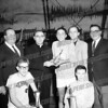 Bob Going wrote about this photo on Oct 29th;<br /> <br /> CYO tournament, c. 1965. Receiving MVP trophy, future superstar Joe Bialobok next to coach Joe Babrow. At their feet looks like Bernie Welch receiving Master Congeniality award :)