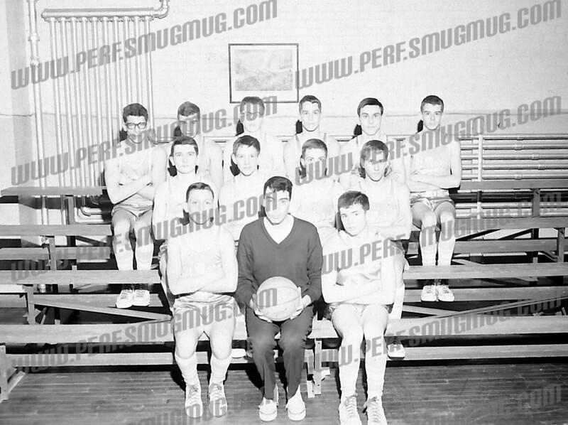 SMI jv's, 1964-65. Front row l-r Mike Skaradek, Coach Tony Roman, Bill Whelly.<br /> 2nd row Mike Dufresne, Bill Dado, Hank Kelly, Jim Morrell?<br /> Third row Chris Cortese, Dave Montenaro, Tim List, ?, Joe Ukeritis, Tom eckert