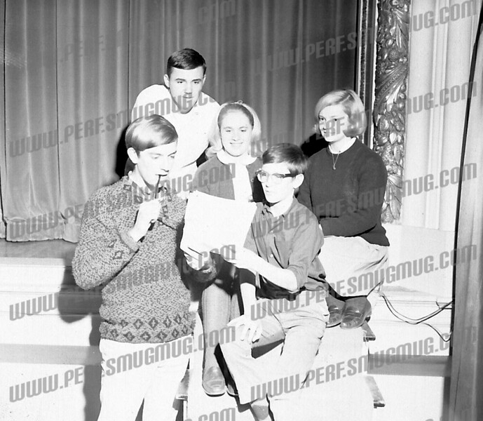 Squatting on stage is Michael Lynch, a medic killed in Vietnam, probably rehearsing Alice in Wonderland with Christine Boice center.