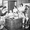 Alan Fox (alan707@earthlink.net) wrote about this photo on Aug 20th<br /> <br /> <br /> My first day at school. Mrs. Irene Baltz's kindergarden class at Arnold Avenue School. Sept. 1955. I was 4 years old, but allowed in. Today you need to be 5 by Sept.1. tThen you needed to be 5 by Jan.1 following start of school.<br />  <br /> Kids from left: 3rd I think is a Hyrzi (sp) with mother, 4th is Dave Zanella, then Cathy Cramer with her mother, Jim Salmon with his mother. Second from right is me. Notice my shoes!