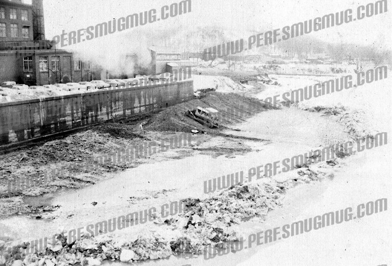 Looks like construction of the flood wall on south side of river, Chalmers building on left, looking west. c. 1960