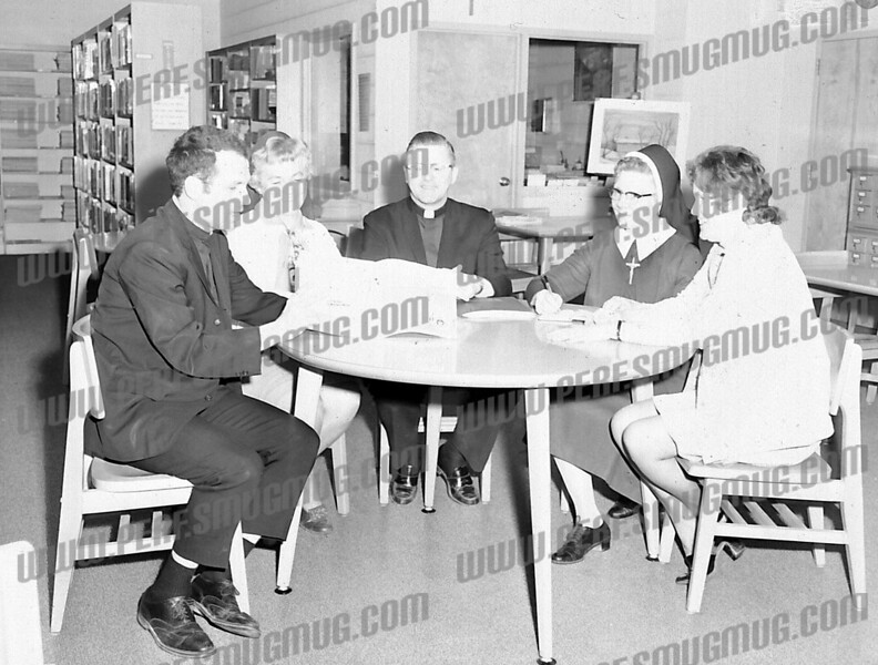 Rev. Joseph Anselment, left, takes command of Bishop Scully High School, fall, 1968, supported by leaders of city's parochial schools. Rev. Donald Kelly, SMI, center.