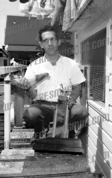 Paul Wyzomirski wrote about this photo on Nov 12th;<br /> <br /> Vince Condello ,avid pigeon raiser and racer.<br /> Vince,my Uncle Steve Popielarz and Eddy Buczek were just a few of the many Amsterdamians involved in pigeon racing<br /> which was a big operation at one time in the city. The pigeon club was on one of the east end streets(maybe Eagle)