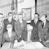 Mayor John P. Gomulka signed. Corporation Counsel Joseph Jacobs standing at extreme right.