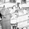 In this picture is of Judge White being sworn in with his family surronding him. The 2 girls on the right the tall one is Nancy and the girl in front is Carolyn