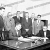 Looks like Board of Supervisors, c. 1961, with County Attorney Gene Catena standing left and Mohawk Supervisor Francis Dimond seated right.