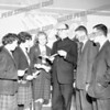 Rev. John Manion with St Mary's Institute students. Father Manion came to SMI in the fall of 1960 and stayed for a couple of years.