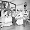 Mrs. Silk, the children's librarian at Amsterdam Free Library, c. 1963. Standing in front of her SMI student Dale Going.