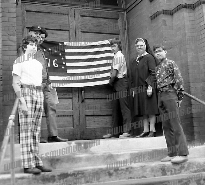 Looks like St. Stanislaus School, bicentennial flag dates it as 1976.,<br /> <br /> Sure is! And it is four boys from the Class of 1976! To the left of the flag is (first row up) Edward Wojicki, Mr. Marshall Lech and Philip Zawisa and to the right of the flag (first row up) David Trzaskos, Sr. Ann Marie Ciulik and Joseph Kwiatkowski.
