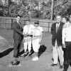 Mayor Frank Martuscello handing out ball.
