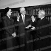 Judge Felix Aulisi administering oath to William J. Crangle (with Mrs. Crangle watching) either as District Attorney or County Court Judge (probably the latter). Historically interesting because Aulisi had run against and beaten Crangle's father.