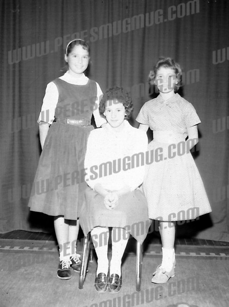 """Sharon Wing Noel (mommapoppadukes@gmail.com) wrote about this photo on Mar 3rd,<br /> <br /> I recognize this picture - from left to right, Janice Hinkle, Betty Anne Levine (sitting) and me, """"Sherry"""" Wing - just after we were chosen to as """"Princesses"""" and """"Queen"""" for the 1st. Little Giants Turkey Bowl. Betty Anne was the Queen and Janice and I were Princesses.I think that this would have been November, 1960."""