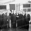 """Supreme Court Justice Felix Aulis swearing in the Common Council of the City of Amsterdam, Jan. 1, 1964. At left 4th Ward Alderman Steve Rutkowski. Fourth from left John Campbell, last two are 2nd Ward John McGratten and Angelo """"Suzy"""" Sardonia of the 5th Ward,second from left Alex Sliva"""