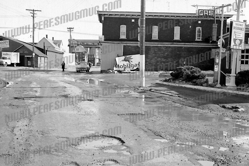 Five corners on Church Street, looking toward Kellogg Street. Wytrwal's coal yard is now the site of Ihor Rymaruk's new self-storage units. Woody's paper products is Peddler's Wagon and Cork Hill Liquor. The Mobil Station was much smaller and didn't take up the whole block as it does now. c. 1960.<br /> (For those who remember the good old days, take a look at those potholes.)
