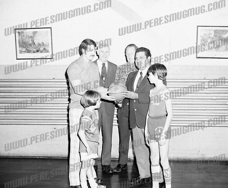 Pete Phelps explaining finer points of basketball to Tony Barone, YMCA Church League, c. 1979