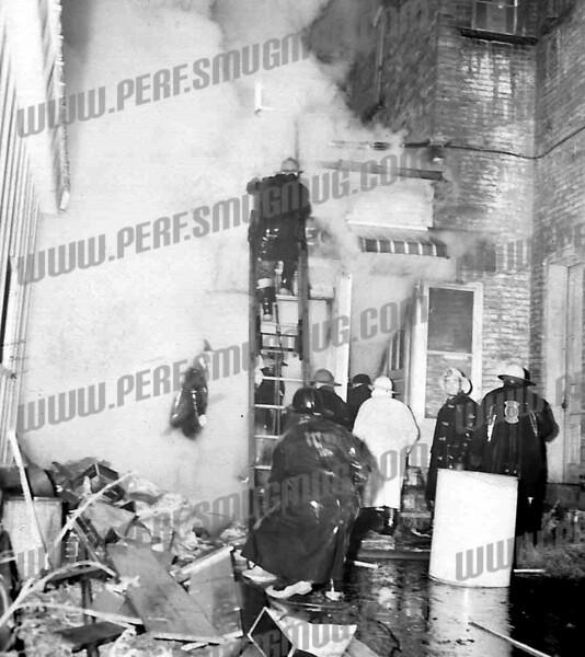 24-31 Market St. F F Leo Podolec in the smoke on left and Lt. Chris Bonefede facing camera.