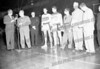 C. 1949/50 Looks like SMI basketball coach Alex Isabel with Amsterdam boys playing for championship Siena College: First one may be Jake LaBate, then Ralph Fedullo and Tony Fabozzi (in civilian clothes).