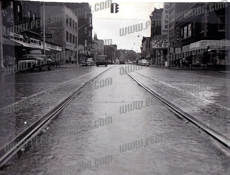 The trolley tracks are probably still under the Riverfront Center. Every effort to cover them failed after not too much time had passed.