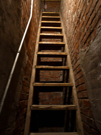 Stairway/ladder to Attic. Very narrow and steap but I went up it . Another ladder was in the middle of the room going up to the cupola. Wish I had gone up this on also.