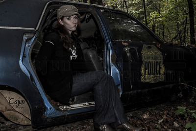 Ms. Kelli in the Police Car - Take One  Old Car City in White Ga.  Photography By:Lloyd R. Kenney III © 2013 All Rights Reserved. Email: LloydKenneyiii@gmail.com