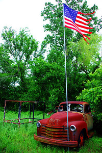 Old truck and Old Glory, near Gonzales, TX