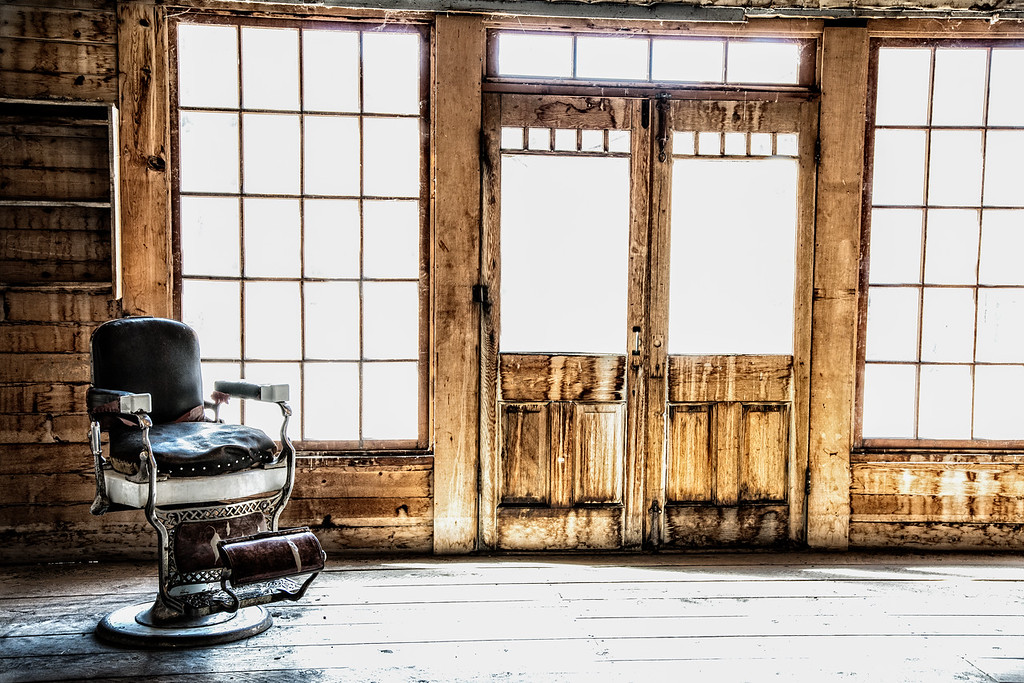 April 20 - Gone<br /> <br /> It's been awhile since I have had the opportunity to post!  This is an image taken in an old abandoned saloon where this barber chair was standing in the corner.  From the looks of it, the chair had been well used.