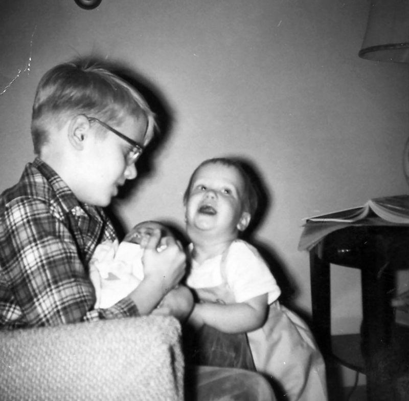 Wally holding Susan while Scott laughs.  1965
